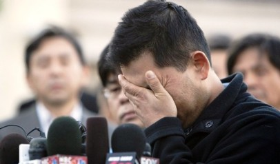 Dong Yun Yoon cries while talking about losing his wife, two daughters, and mother-in law after an F/A-18D fighter jet crashed into his house in the University City neighborhood of San Diego, California December 9, 2008. The victims were identified as Dong Yun Yoon's wife Young M. Yoon, and their daughters 15-month-old Grace and 12-month-old Rachel. Young Yoon's mother, Suk Kim, who was visiting from South Korea also perished in the crash. The family had moved to the neighborhood a month ago. Dong Yun Yoon was at work at the time of the accident.